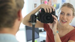 Young fashion photographer shooting in studio Stock Footage
