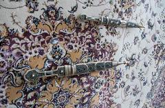 dagger damascus steel on the carpet - stock photo