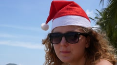 Christmas and New Year Celebration. Santa Woman Portrait on the Beach. Stock Footage