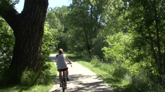 Stock Video Footage of Recreation Black Hills Summer Bike Riding Trail Cottonwood Seeds