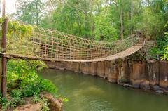 Bamboo bridge over the river in tad pha souam waterfall at paksa south laos Stock Photos