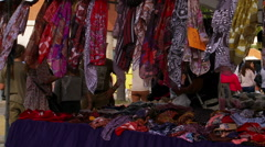 Scarves blowing in the wind. Estepona street market Stock Footage