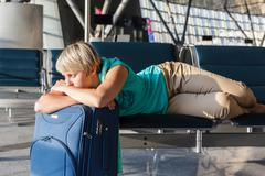 beautiful young woman at the airport - stock photo