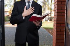 jehovah's witness standing at the door - stock photo