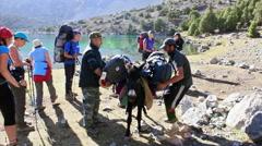 On a donkey loaded with backpacks. Tajikistan. 1280x720 Stock Footage