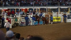 Cowboy saddle bronc ride in rodeo slow motion Stock Footage