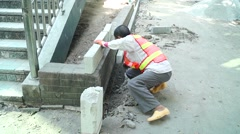 The pavement construction, the workers are working Stock Footage