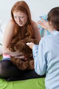 teen admit to pregnancy - stock photo