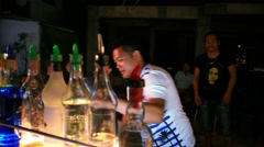 Koh Samui. Thailand. 18 July 2014. Barman to do a cocktail in night street. HD. Stock Footage