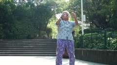 The 80 year old grandmother in physical exercise Stock Footage