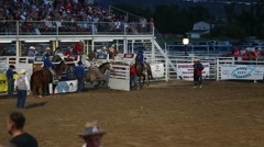 a cowboy saddle bronc ride in rodeo slow motion - stock footage