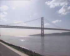 Pan - view downstream 25 de Abril Bridge LISBON, PORTUGAL Stock Footage