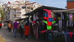 People stroll through Estepona street market Stock Footage