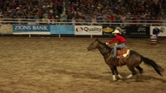 Cowgirl barrel racing at rodeo slow motion Stock Footage