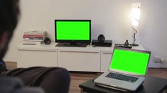 Man Watches Green Screened Tv computer living room - Full HD Stock Footage