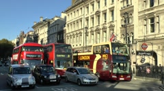 London buses in Westminster, London, UK. - stock footage