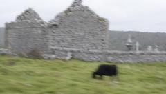 Irish countryside on a cloudy day by bus going by an old stone building Stock Footage