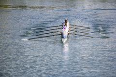 Eight men rowing Stock Photos