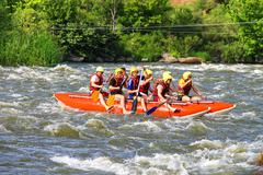 rafting tourists with an experienced instructor on the river southern bug - stock photo