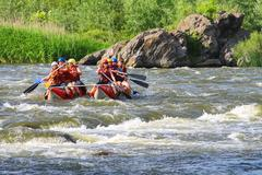 Rafting tourists with an experienced instructor on the river southern bug Stock Photos