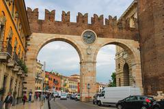 Stock Photo of people and vehicles near the medieval city gates on portoni della bra. verona