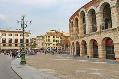 people in the area near verona arena in preparation for the annual festival o - stock photo