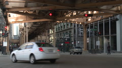 Cars Pass Under Chicago Train Tracks Stock Footage