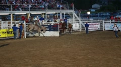 a cowboy bronc ride in rodeo slow motion - stock footage