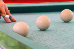 hand with cue before the a blow to the billiard ball - stock photo