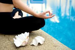 yoga meditation hand by pool - stock photo