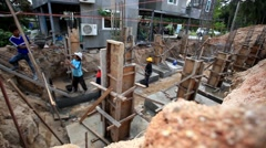Koh Samui, Thailand 18 July 2014. Manual workers building a house, working on Stock Footage