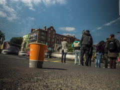 Time lapse of pedestrians walking past paper cup - 4.6k Stock Footage