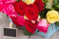 Stock Photo of red and pink  roses  on table