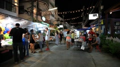 Koh Samui, Thailand 18 july 2014 Unidentified tourists walk along night street. Stock Footage