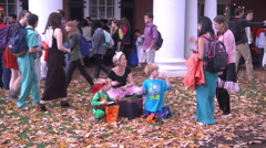 Halloween families and costumes exterior afternoon Stock Footage