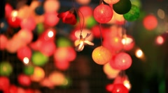 Stock Video Footage of Christmas garland blurred lights background with different colors. HD. 1920x1080