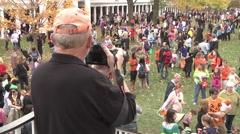 Halloween festivities pan crowd exterior high angle Stock Footage