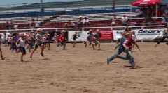 a kids pig chase at kids rodeo - stock footage