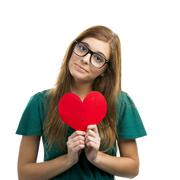Beautiful woman holding a paper hearth Stock Photos