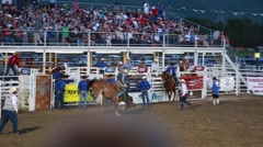 a cowboy riding a bronc at rodeo slow motion - stock footage