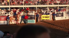 A cowboy bareback riding at rodeo slow motion Stock Footage