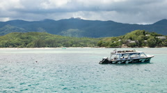 Floating Boat in front of Rainforrest Island // Seychelles HD Stock Footage