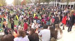 Halloween festivities wide shot of hugh crowd exterior afternoon Stock Footage