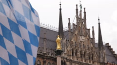 German Bavarian Flag Mariensaule Marian Column Golden Statue Marienplatz Munich - stock footage