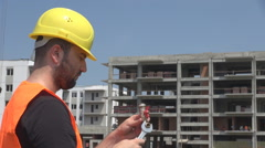 Young engineer use wrench for fixing water tap network, construction in progress Stock Footage