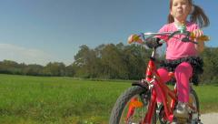 HD Slow-Mo: Cute Little Girl on a Red Bike Stock Footage