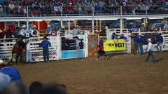 a cowboy bronc ride at rodeo slow motion - stock footage