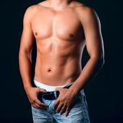 sunburnt muscular male torso in the jeans - stock photo