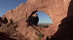 Desert Arches National Park Spring People Walking Arch - stock footage