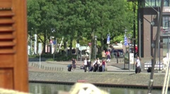 Passengers approaching Charter ship on a quay in the harbour of Enkhuizen - stock footage
